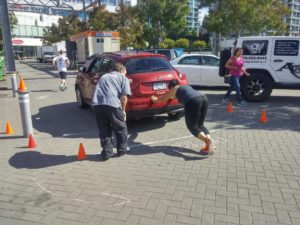 Pushing a car at the end of the obstacle course event